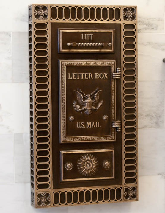 Intricate Bronze Mailbox in Lobby